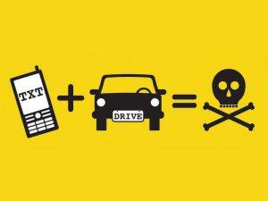 Make the glove box the phone box or risk a £200 fine
